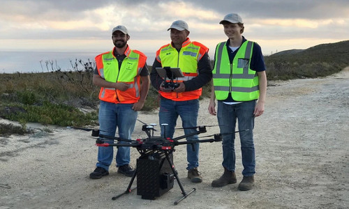 Personnel with their aerial drone.